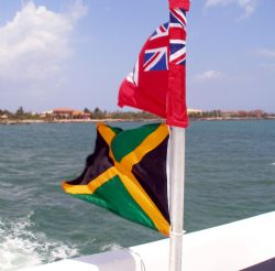 Cayman Islands and Jamaican flags displayed on the Ray Ex... by Andrew Kubica